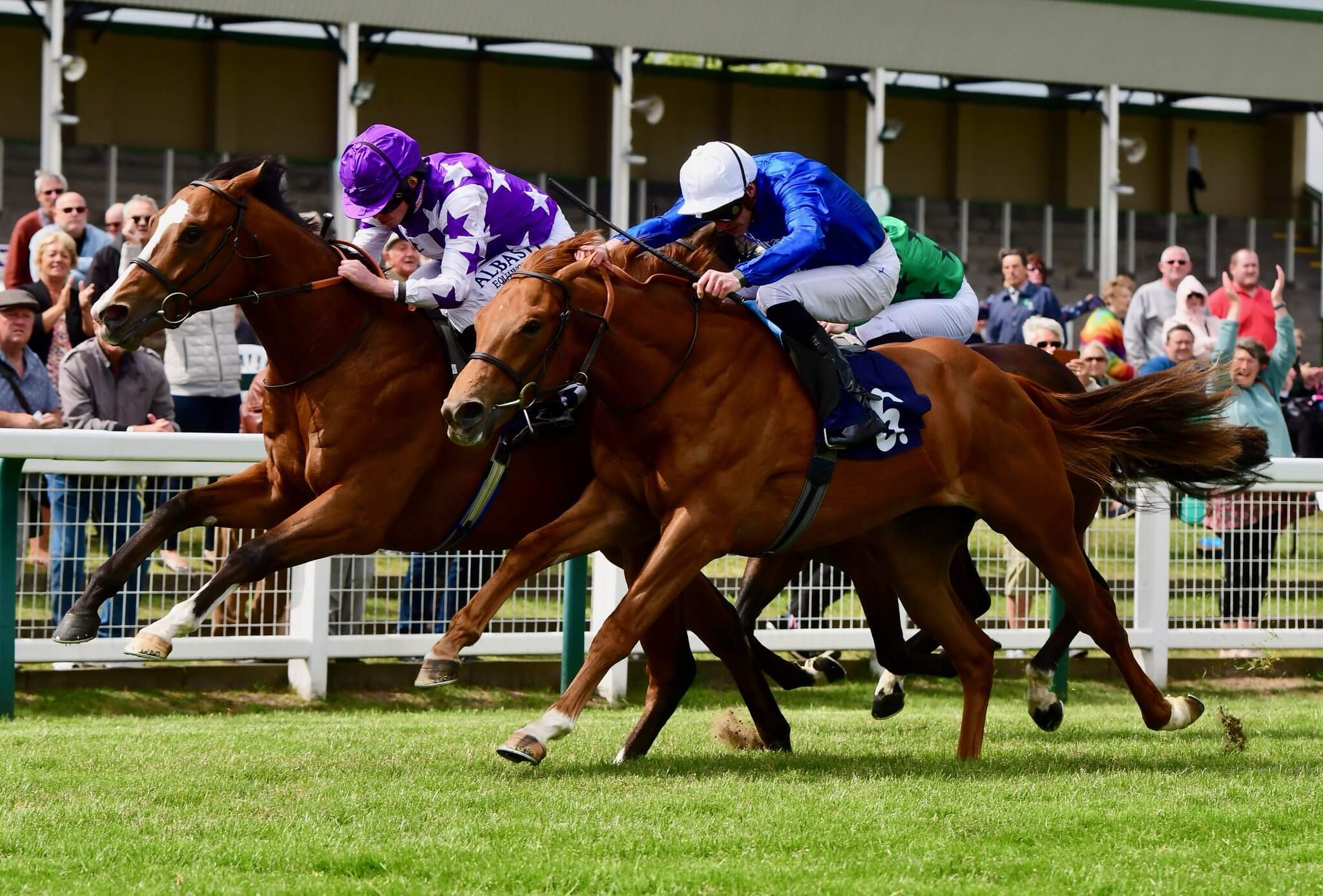 Pictured far side, Yearling Purchase Maxi Boy (Oasis Dream) winning on debut at Yarmouth
